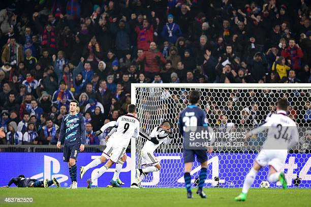 Basel's Paraguayan midfielder Derlis Gonzalez celebrates after opening the scoring during the UEFA Champions League round of 16 first leg football...