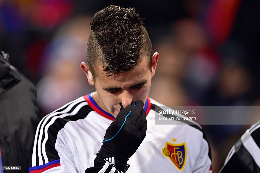 Basel's Paraguayan midfielder Derlis Gonzalez reacts after being injured during the UEFA Champions League round of 16 first leg football match between Basel (FCB) and Porto (FCP) on February 18, 2015 at the St. Jakob-Park stadium in Basel.
