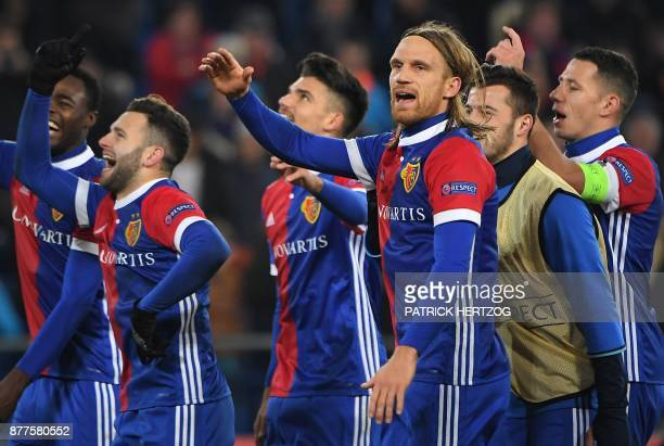 Basel's players celebrate at the end of the UEFA Champions League Group A football match between FC Basel and Manchester United at Saint JakobPark...