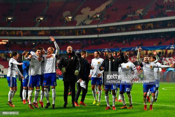 Basel's players celebrate at the end of the UEFA Champions League football match SL Benfica vs FC Basel at the Luz stadium in Lisbon on December 5...