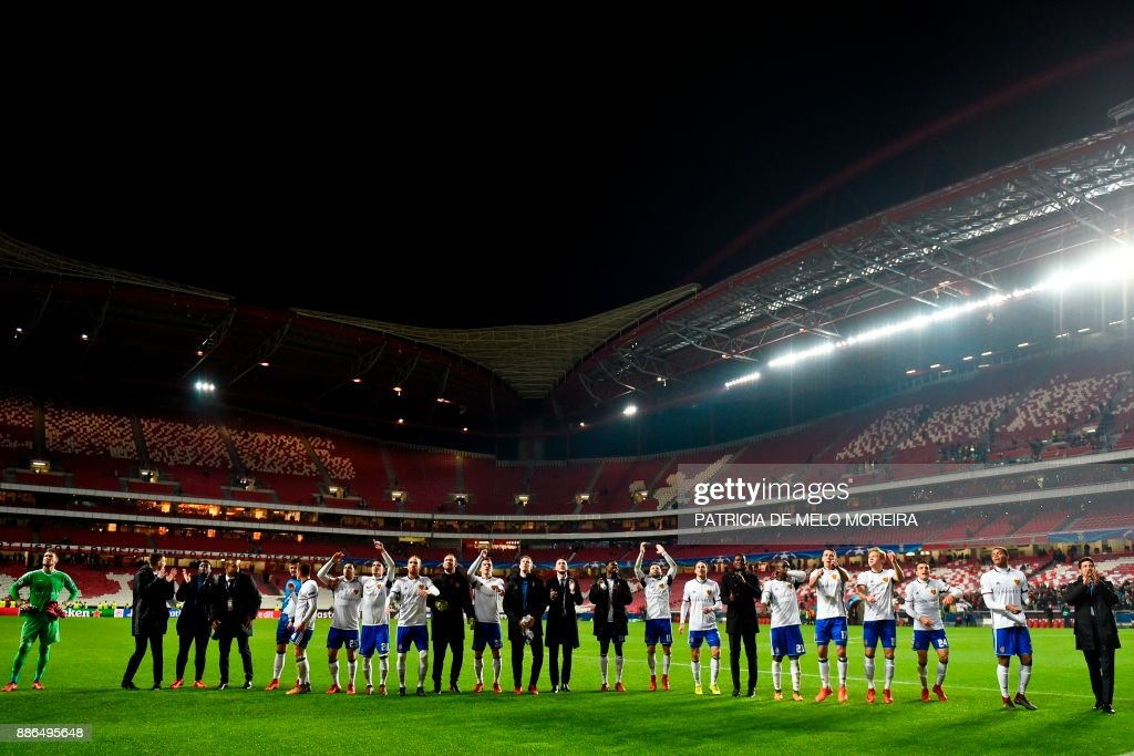 Basel's players celebrate at the end of the UEFA Champions League football match SL Benfica vs FC Basel at the Luz stadium in Lisbon on December 5, 2017. /
