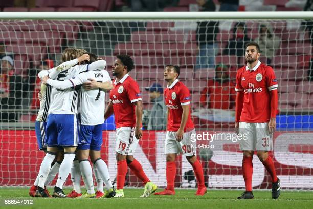 Basel's players celebrate the victory after the UEFA Champions League Group A football match between SL Benfica and FC Basel at the Luz stadium in...