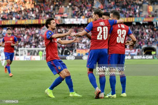 Basel's players celebrates after FC Basel's Swiss midfielder Kevin Bua scored the team's first goal during the UEFA Europa League group C football...