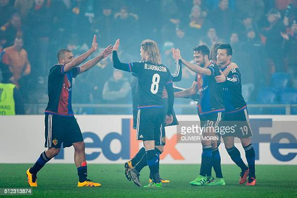 FC Basel's players celebrates their qualification at the end of the UEFA Europa League round of 32 second leg football match between FC Basel and...