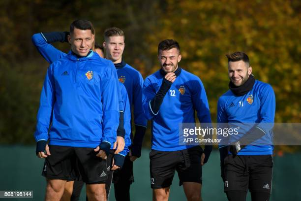 Basel's players Czech defender Marek Suchy Swiss forward Cedric Itten Swiss forward Albian Ajeti and Swiss midfielder Renato Steffen attend a...