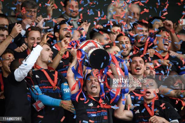 Basel's players raise the trophy after winning the Swiss Football Cup final against FC Thun at the Stade de Suisse stadium on May 19, 2019 in Bern.