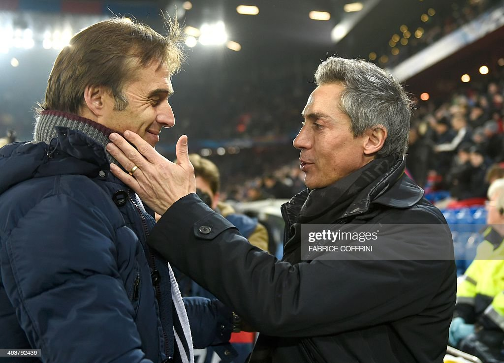 Basel's Portuguese head coach Paulo Sousa (R) greets Porto's Spanish coach Julen Lopetegui prior to the UEFA Champions League round of 16 first leg football match between Basel (FCB) and Porto (FCP) on February 18, 2015 at the St. Jakob-Park stadium in Basel.