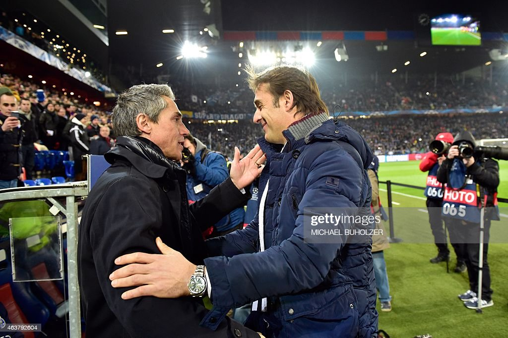 Basel's Portuguese head coach Paulo Sousa (L) greets Porto's Spanish coach Julen Lopetegui prior to the UEFA Champions League round of 16 first leg football match between Basel (FCB) and Porto (FCP) on February 18, 2015 at the St. Jakob-Park stadium in Basel.