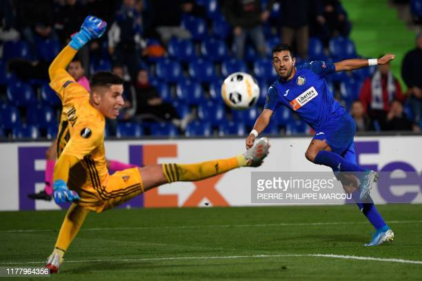 FC Basel's Serbian goalkeeper Dorde Nikolic stops the ball kicked by Getafe's Spanish forward Angel Rodriguez during the UEFA Europa League group D...
