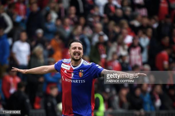 Basel's Serbian midfielder Zdravko Kuzmanovic celebrates after winning the Swiss Football Cup final match between FC Basel 1893 and FC Thun at the...