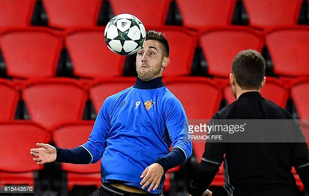 Basel's Slovenian striker Andraz Sporar controls the ball during a training session on October 18 2016 at the Parc des Princes stadium in Paris on...