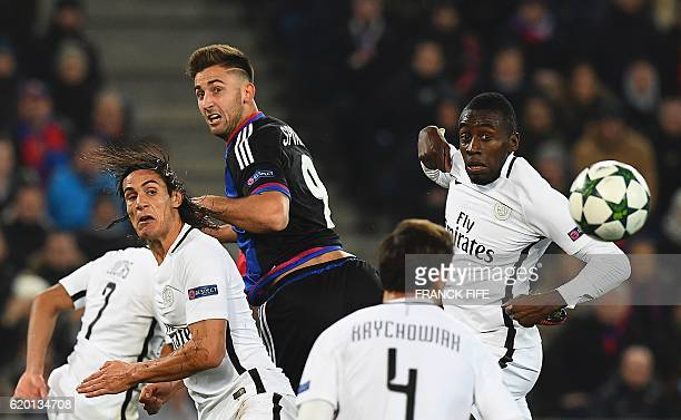 Basel's Slovenian striker Andraz Sporar with Paris SaintGermain's Uruguayan forward Edinson Cavani and Paris SaintGermain's French midfielder Blaise...