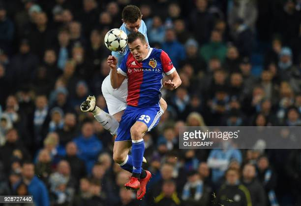 Basel's Spanish midfielder Kevin Bua vies with Manchester City's French defender Aymeric Laporte during the UEFA Champions League round of sixteen...