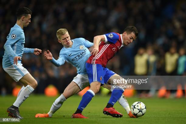 Basel's Spanish midfielder Kevin Bua vies with Manchester City's Ukrainian midfielder Oleksandr Zinchenko and Manchester City's English midfielder...