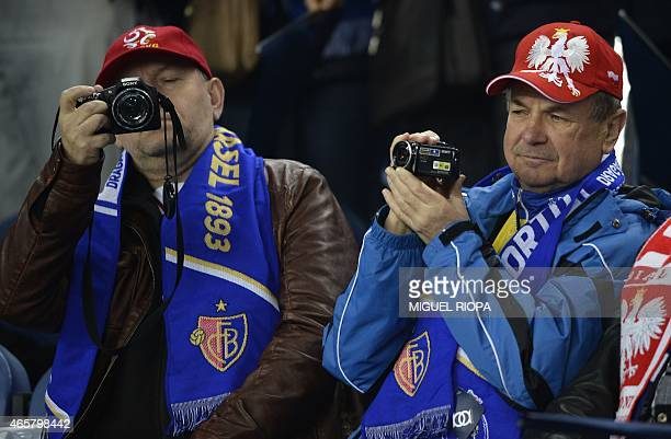 Basel's supporters take pictures before the UEFA Champions League round of 16 second leg football match FC Porto vs FC Basel at the Dragao stadium in...