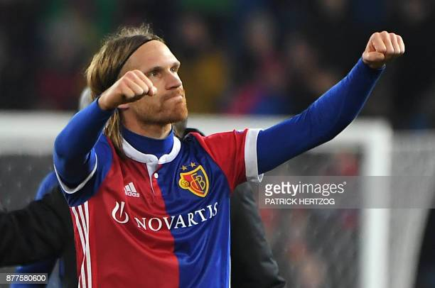 Basel's Swiss defender Michael Lang celebrates at the end of the UEFA Champions League Group A football match between FC Basel and Manchester United...