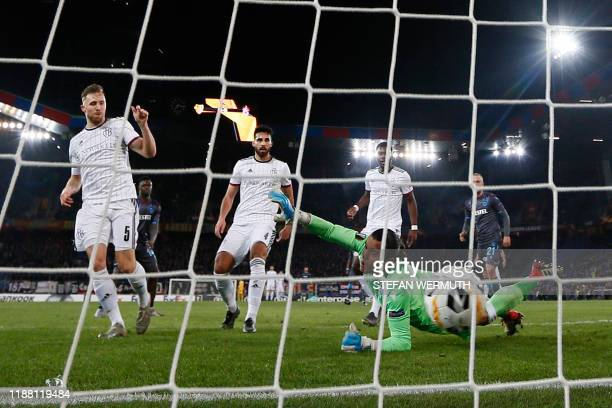 Basel's Swiss defender Silvan Widmer scores during the UEFA Europa League Group D football match between FC Basel 1893 and Trabzonspor AS at the St....