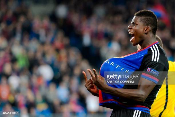 """Basel's Swiss forward Breel Embolo flashes the """"V for Victory"""" sign as he celebrates with a ball under his jersey after scoring the team's second..."""