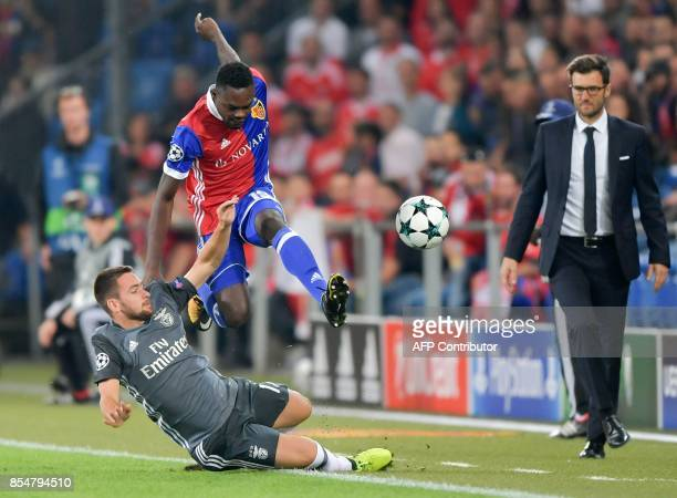 Basel's Swiss forward Dimitri Oberlin fights for the ball with Benfica's Serbian forward Andrija Zivkovic as Basel's Swiss head coach Raphael Wicky...