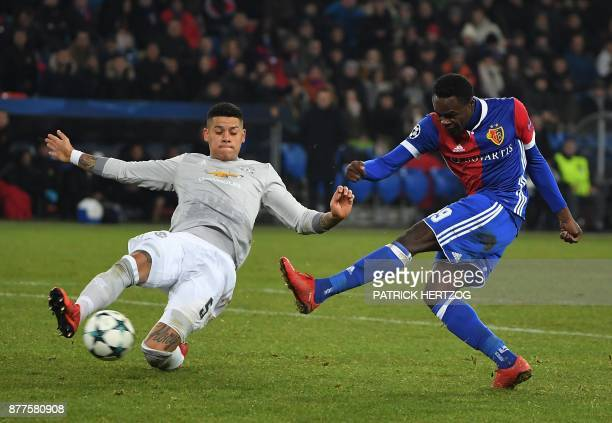 Basel's Swiss forward Dimitri Oberlin vies with Manchester United's English defender Luke Shaw during the UEFA Champions League Group A football...