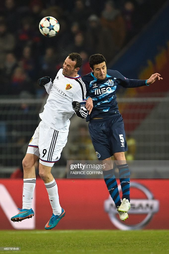 Basel's Swiss forward Marco Streller (L) and Porto's Spanish defender Ivan Marcano go for a header during the UEFA Champions League round of 16 first leg football match between Basel (FCB) and Porto (FCP) on February 18, 2015 at the St. Jakob-Park stadium in Basel.