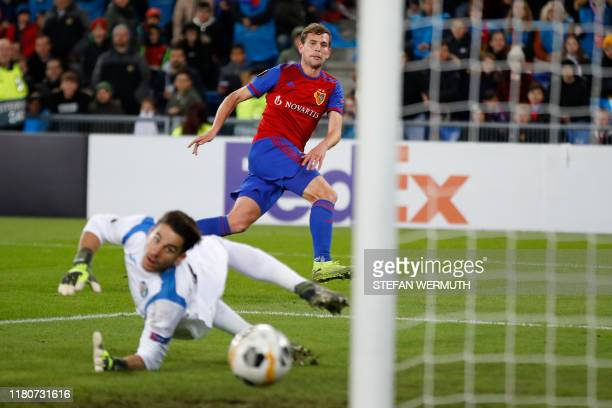 Basel's Swiss midfielder Fabian Frei shoots and scores a goal during the UEFA Europa League group C football match between FC Basel and Getafe CF at...