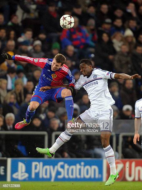 Basel's Swiss midfielder Fabian Frei vies for the ball with Chelsea's Nigerian midfielder John Mikel Obi during the UEFA Champions League group E...