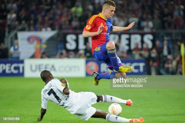 Basel's Swiss midfielder Fabian Frei vies with Chelsea's Brazilian midfielder Ramires during an UEFA Europa League first leg semifinal football match...
