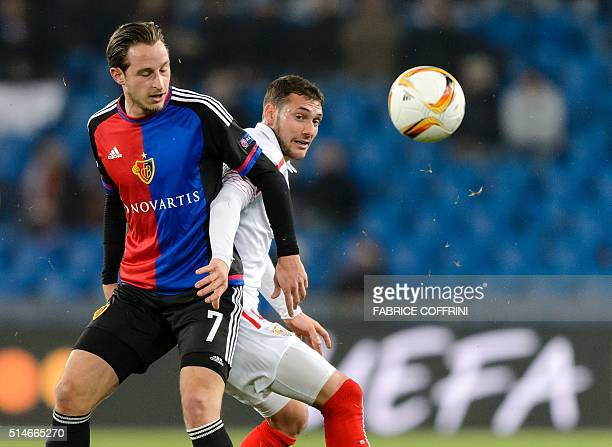 Basel's Swiss midfielder Luca Zuffi and Sevilla's Uruguayan midfielder Sebastian Cristoforo vie during the UEFA Europa League round of 16 first leg...