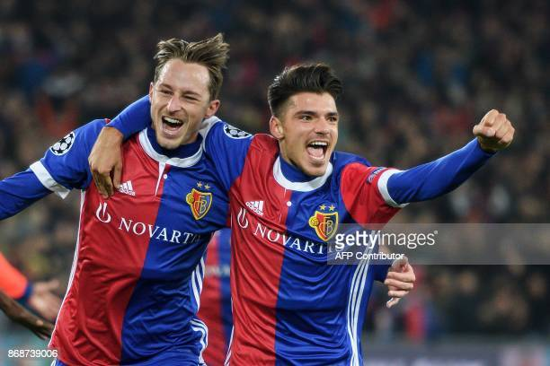 Basel's Swiss midfielder Luca Zuffi celebrates with teammate Basel's Italian defender Raoul Petretta after scoring a goal during the UEFA Champions...