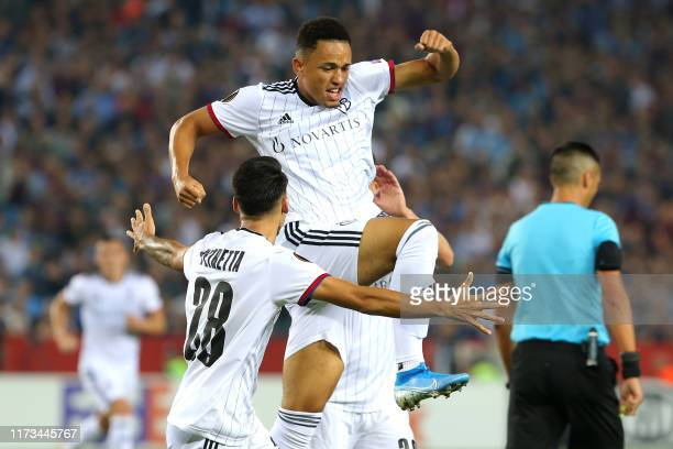 Basel's Swiss midfielder Noah Okafor celebrates with his teammates after scoring a goal during the UEFA Europa League group C football match between...