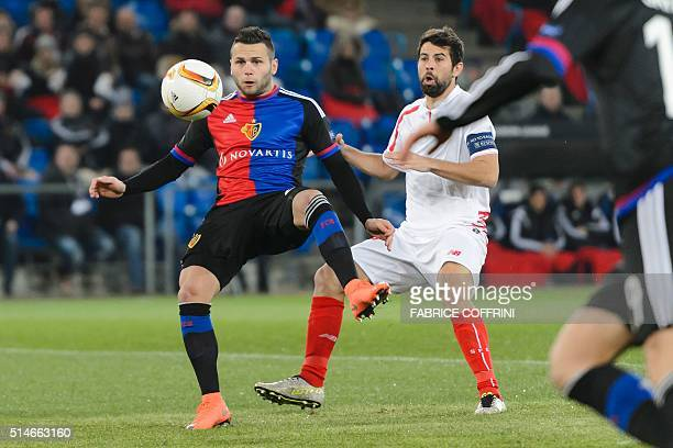 Basel's Swiss midfielder Renato Steffen vies with Sevilla's defender Coke during the UEFA Europa League round of 16 first leg football match between...