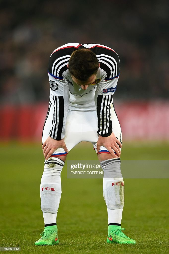 Basel's Swiss midfielder Taulant Xhaka reacts during the UEFA Champions League round of 16 first leg football match between Basel (FCB) and Porto (FCP) on February 18, 2015 at the St. Jakob-Park stadium in Basel.