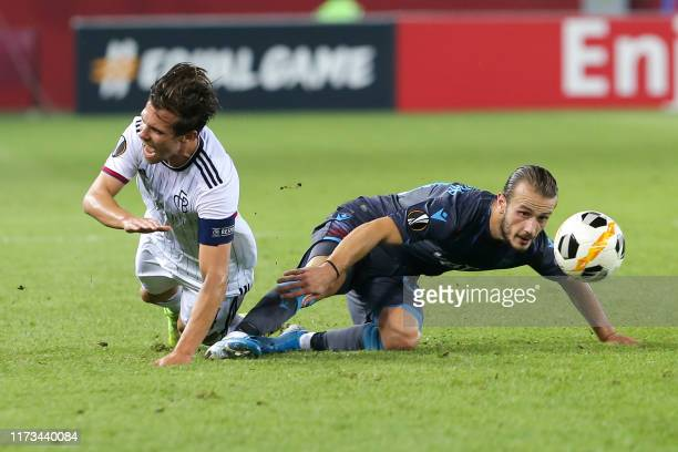 Basel's Swiss midfielder Valentin Stocker and Trabzonspor's Turkish midfielder Abdulkadir Parmak fight for the ball during the UEFA Europa League...