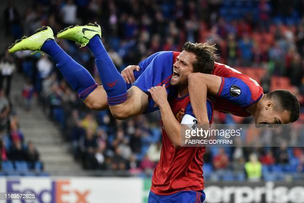 Basel's Swiss midfielder Valentin Stocker celebrates after scoring the team's second goal scored by FC Basel's Swiss midfielder Kevin Bua during the...