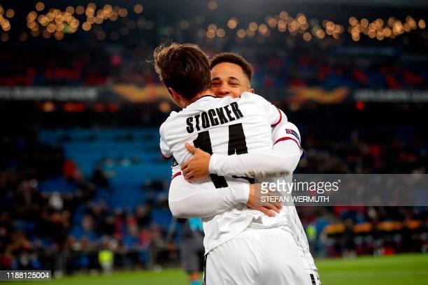 Basel's Swiss midfielder Valentin Stocker celebrates with teammate Swiss midfielder Noah Okafor after scoring a goal during the UEFA Europa League...
