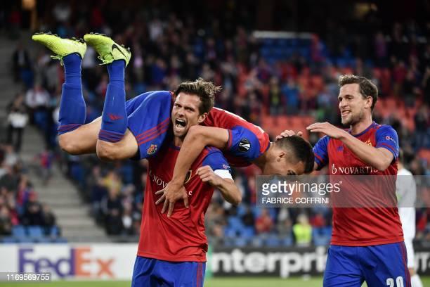 Basel's Swiss midfielder Valentin Stocker, FC Basel's Swiss midfielder Kevin Bua and FC Basel's Swiss midfielder Fabian Frei celebrate after scoring...
