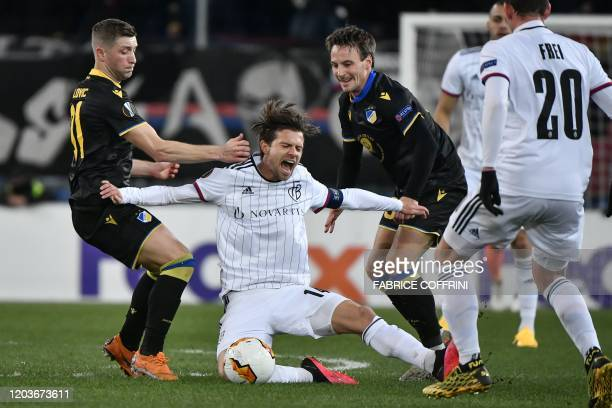 FC Basel's Swiss midfielder Valentin Stocker vie for the ball with APOEL Nicosia's Bosnian defender Dragan Mihajlovic and APOEL Nicosia's Danish...