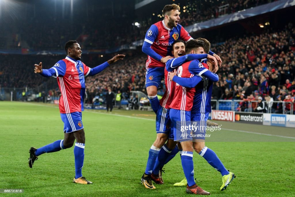 Basel's team players celebrate after scoring a goal during the UEFA Champions League Group A football match between FC Basel and CSKA Moscow at Saint Jakob-Park Stadium on October 31, 2017 in Basel. / AFP PHOTO / Fabrice COFFRINI