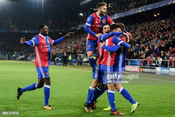 Basel's team players celebrate after scoring a goal during the UEFA Champions League Group A football match between FC Basel and CSKA Moscow at Saint...