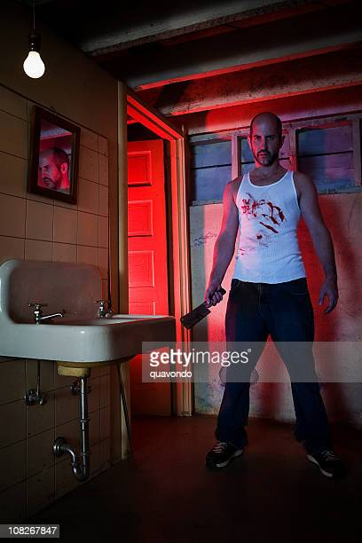 Basement Bathroom with Scary Bloody Killer Holding Knife