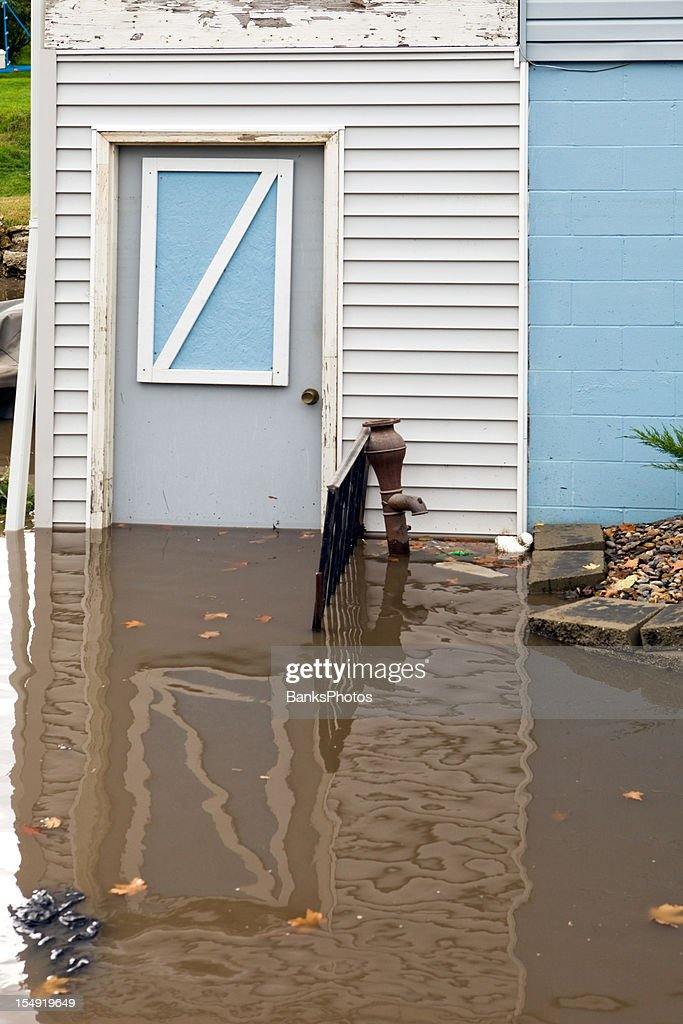 Basement Entry Door with Floodwater : Stock Photo
