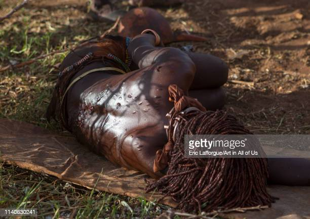 Bashada tribe woman whipped during a bull jumping ceremony Dimeka Omo valley Ethiopian on December 28 2013 in Dimeka Ethiopia