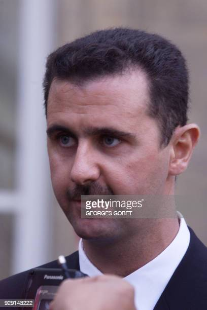 Bashar alAssad son of Syrian President Hafez alAssad answers media 07 November 1999 in the courtyard of the Elysée Palace after his meeting with...
