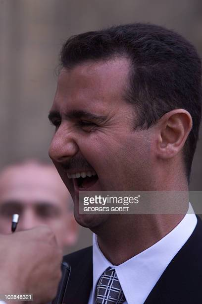 Bashar alAssad son of Syrian President Hafez alAssad laughs 07 November 1999 in the courtyard of the Elysée Palace after his meeting with French...