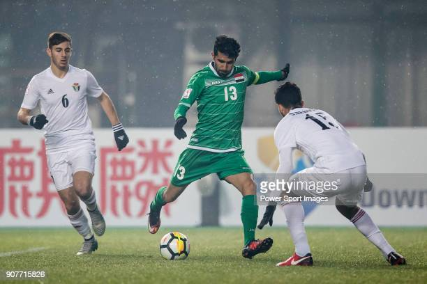 Bashar Resan of Iraq fights for the ball with Ibrahim Al Khob of Jordan and Saed Al Rosan of Jordan during the AFC U23 Championship China 2018 Group...