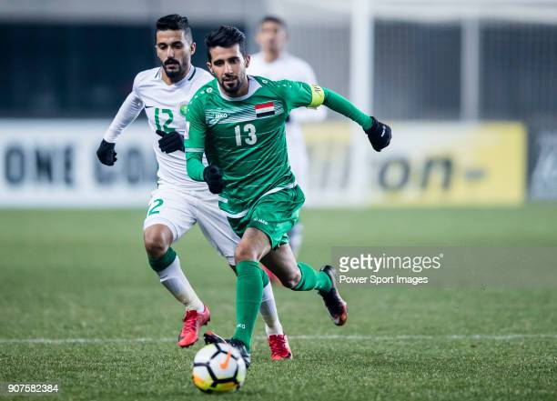 Bashar Resan of Iraq fights for the ball with Mohammed Al Baqawi of Saudi Arabia during the AFC U23 Championship China 2018 Group C match between...