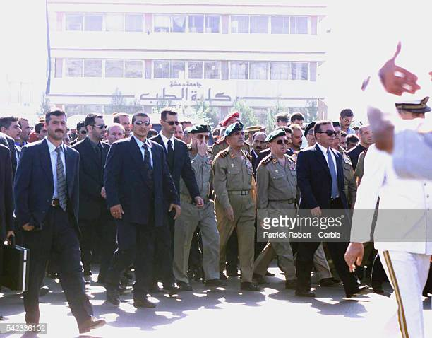 Bashar son of Hafez walking behind his father's coffin