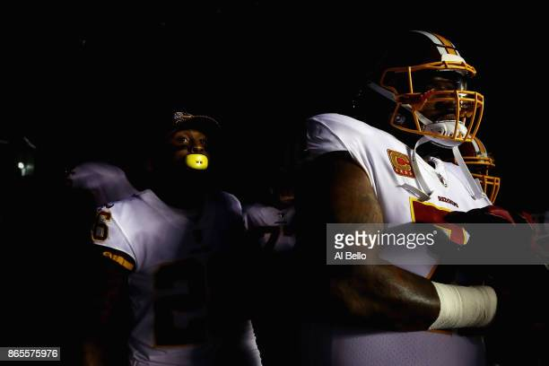 Bashaud Breeland and Trent Williams of the Washington Redskins wait in the tunnel before taking the field to play against the Philadelphia Eagles at...