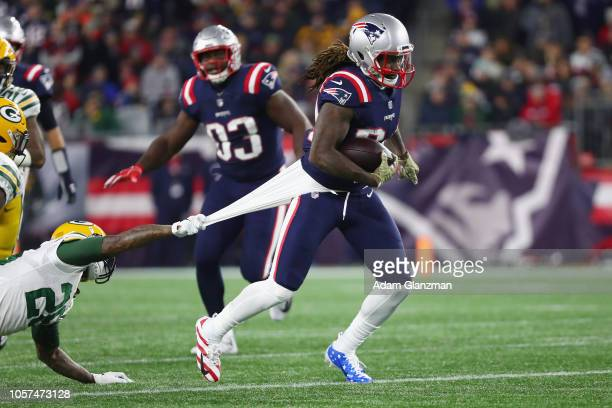 Bashaud Breeland of the Green Bay Packers grabs the shirt of Cordarrelle Patterson of the New England Patriots during the first half at Gillette...